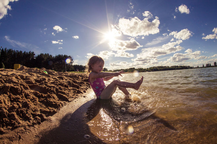Beach Beauty In Nature Childhood Cloud - Sky Day Full Length Land Leisure Activity Lens Flare Lifestyles Nature One Person Outdoors Real People Sea Sky Sunlight Sunny Water