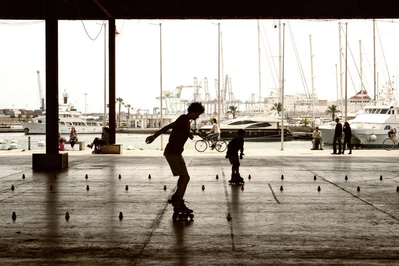 Skater in an old hall at the port of Valencia Harbor Leisure Activity Lifestyles Mast Sailboat Ship Skater The Street Photographer - 2016 EyeEm Awards Weekend The Essence Of Summer- 2016 EyeEm Awards The Essence Of Summer People Of The Oceans