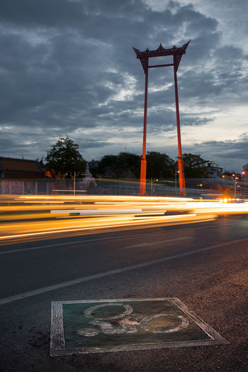 Light trails on street against sky in city