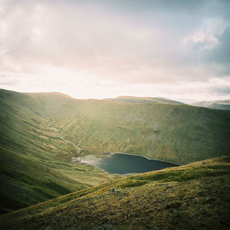 A golden, early-morning vista in England's Lake District. Film Hiking Lake District Winter Active Beauty In Nature Cloud - Sky England Environment Glow Golden Hour Green Color Idyllic Landscape Mountain Mountain Range Nature No People Reservoir Rolling Landscape Scenics - Nature Sky Tranquil Scene Tranquility Warmth