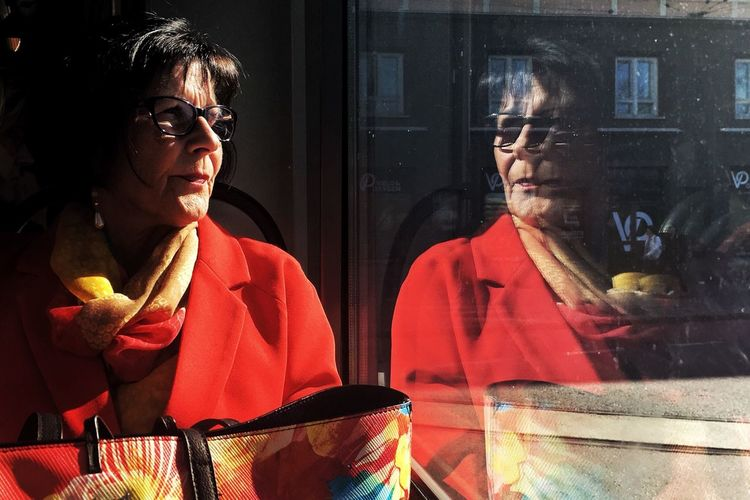 They say the eyes are the mirror of the soul. But how about the window? Streetphoto_color Streetphotography Real People Lifestyles Looking Sitting Young Adult Reflection Looking Away People Portrait