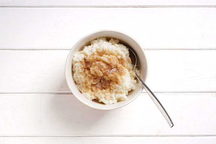 Milchreis (rice pudding) Bowl Copy Space Dessert Directly Above Dish Food German Milchreis Rice Pudding Rustic Spoon Sweet Table Top View Topview Zimt Und Zucker