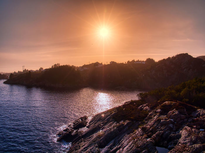 Sunset off Turøy, Bergen Water Sky Sunset Beauty In Nature Tranquility Scenics - Nature Tranquil Scene Sun Sunlight Tree Nature No People Plant Lake Lens Flare Non-urban Scene Idyllic Reflection Outdoors Olympus Landscape_photography Landscape_Collection Fjord