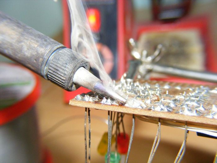 Close-up of circuit board being soldered