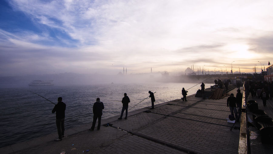City in Fog Streetphotography Street Photography Urban EyeEm Silhouettes Galata People Istanbul Landscape Water Winter Cold Temperature City Sea Silhouette Sunset Beach Men Sky Foggy Weather Countryside Fog Mist Adventures In The City The Street Photographer - 2018 EyeEm Awards