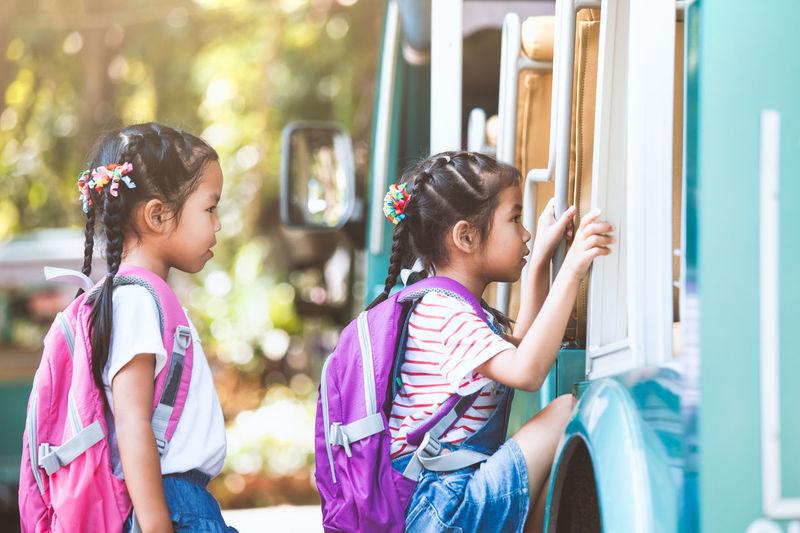 Side View Of Schoolgirls Boarding Miniature Train