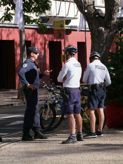 Policemen, Avenida Arriaga Composition Funchal Madeira Portugal Bycicles Full Frame Full Frame Shot Full Length Helmets Instructing Outdoor Photography Police Uniforms Policemen Real People Rear View Standing Street Sunlight And Shadows Tree