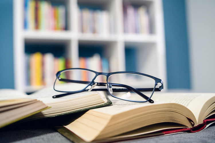 Book Publication Education Eyeglasses  Glasses Still Life Learning Indoors  Table Close-up Literature Wisdom Expertise No People Open Focus On Foreground Stack Paper Selective Focus Shelf Bookshelf Reading Glasses Textbook Eyewear Personal Accessory