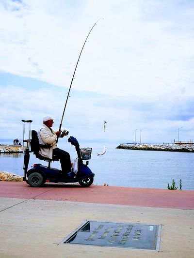 Only Men One Man Only Transportation Sky Cloud - Sky Mode Of Transport Adults Only Adult Day Motorcycle Outdoors Full Length Sitting One Person Water Fish Fisherman Balık Balıkçı Mature Adult People Sea Men Real People