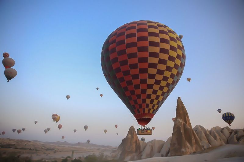 Dreamer's Land: Cappadocia Stockphotography Travel Photography Canon 6D Hopes And Dreams Dreamer Gezilecek Türkiye Kapadokya Candy Happiness Lgbt EyeEm Selects Canon Hot Air Balloon Sky Balloon Transportation Air Vehicle Nature Clear Sky Flying Mode Of Transportation Mid-air Adventure Blue Travel Outdoors Celebration Ballooning Festival Leisure Activity