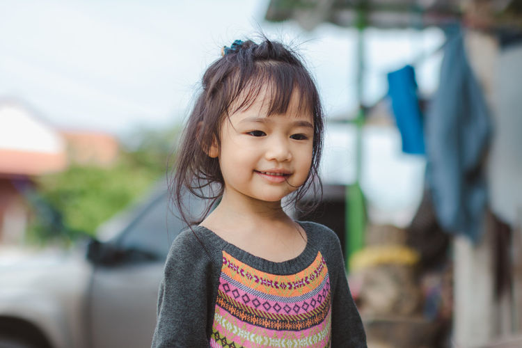 Bangs Casual Clothing Child Childhood Cute Day Emotion Females Focus On Foreground Front View Girls Hairstyle Happiness Innocence Lifestyles One Person Portrait Real People Smiling Women