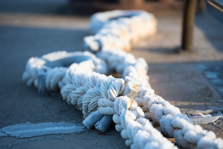Close-up of rope at harbor