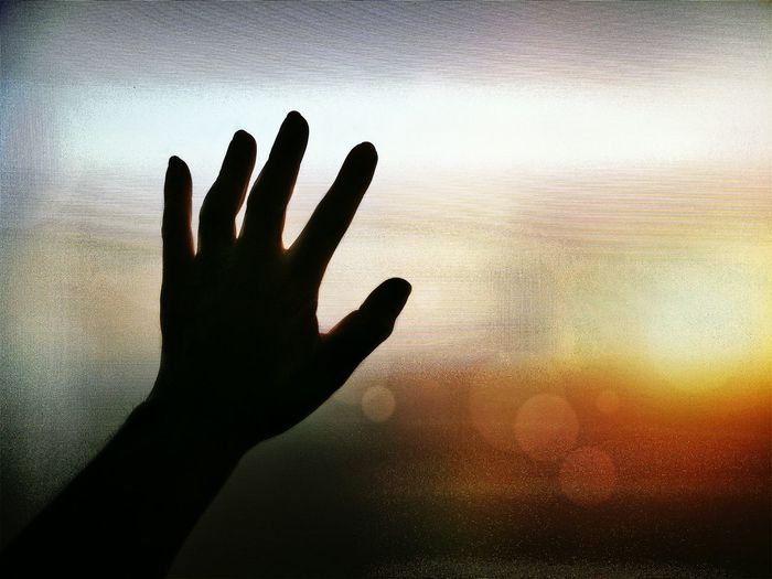 silhouette man's hand on frosted glass with blurred sunrise sky background on hope concept Inside Worry Pattern Texture Man Male Please Touch Imagine Want Silhouette Morning Dramatic Blurred Background Sunrise Hope Copy Space Human Hand Sunset Silhouette Human Finger Close-up Sky Frosted Glass Scenics Sunrise - Dawn Calm Dawn Tranquil Scene Mystery