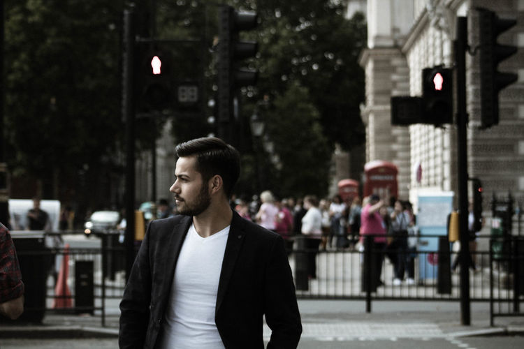 Businessman standing on street in city