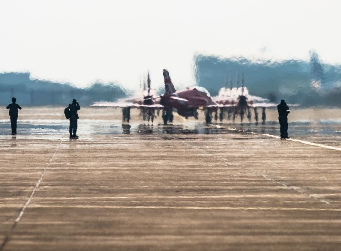Red Arrows Water Wet Sky Men Real People Large Group Of People Outdoors Day Sea Clear Sky Winter Nature Adults Only Cold Temperature People Adult Mammal