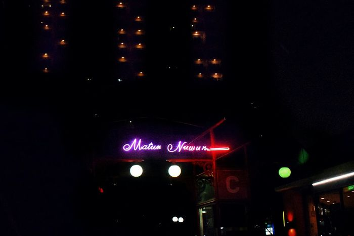 """Matur Nuwun"" is one of Indonesian words, meaning ""Thank You"". Tumblr EyeEmNewHere Surabaya Cityscape Sign Gratitude Shop Streetphotography Streetlights Neon Lights Neon Neon Sign EyeEm Gallery Night Lights No People Outdoors Road Sign"