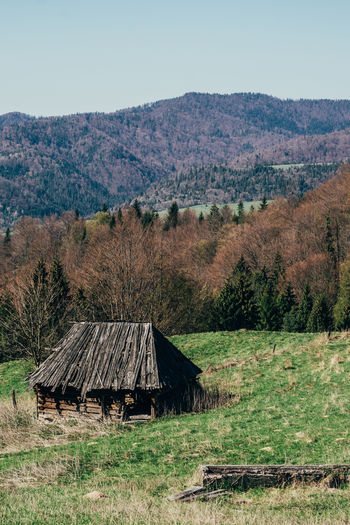 An abandoned old wooden hut in a hilly surrounding. Barn Deterioration Field Grassy Hill Landscape Nature Old Outdoors Pieniny Poland Run-down Rural Scene Tranquility Wooden Hut Old Hut