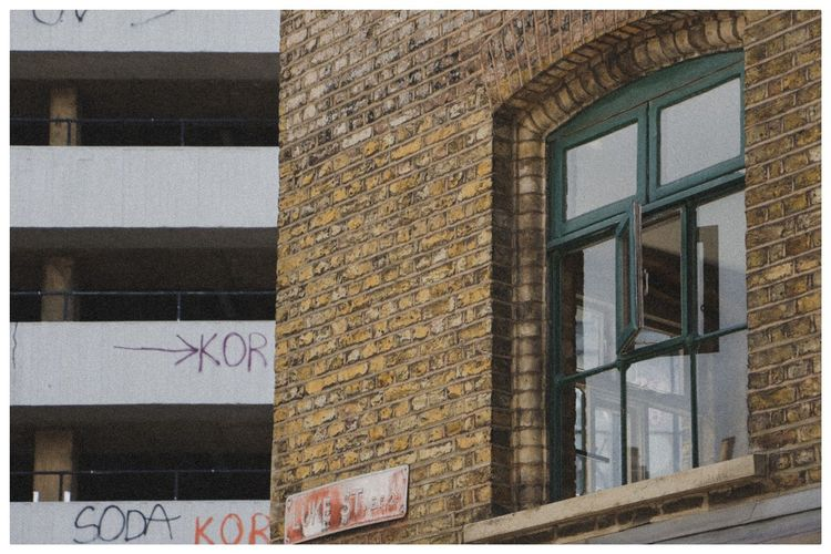 Low angle view of text on glass building