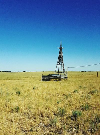 Lone windmill without head North Of Lusk Wyoming In Pasture Tall Grass Blowing In The Wind Relaxing Out In The Country United States Beautiful Summer Morning