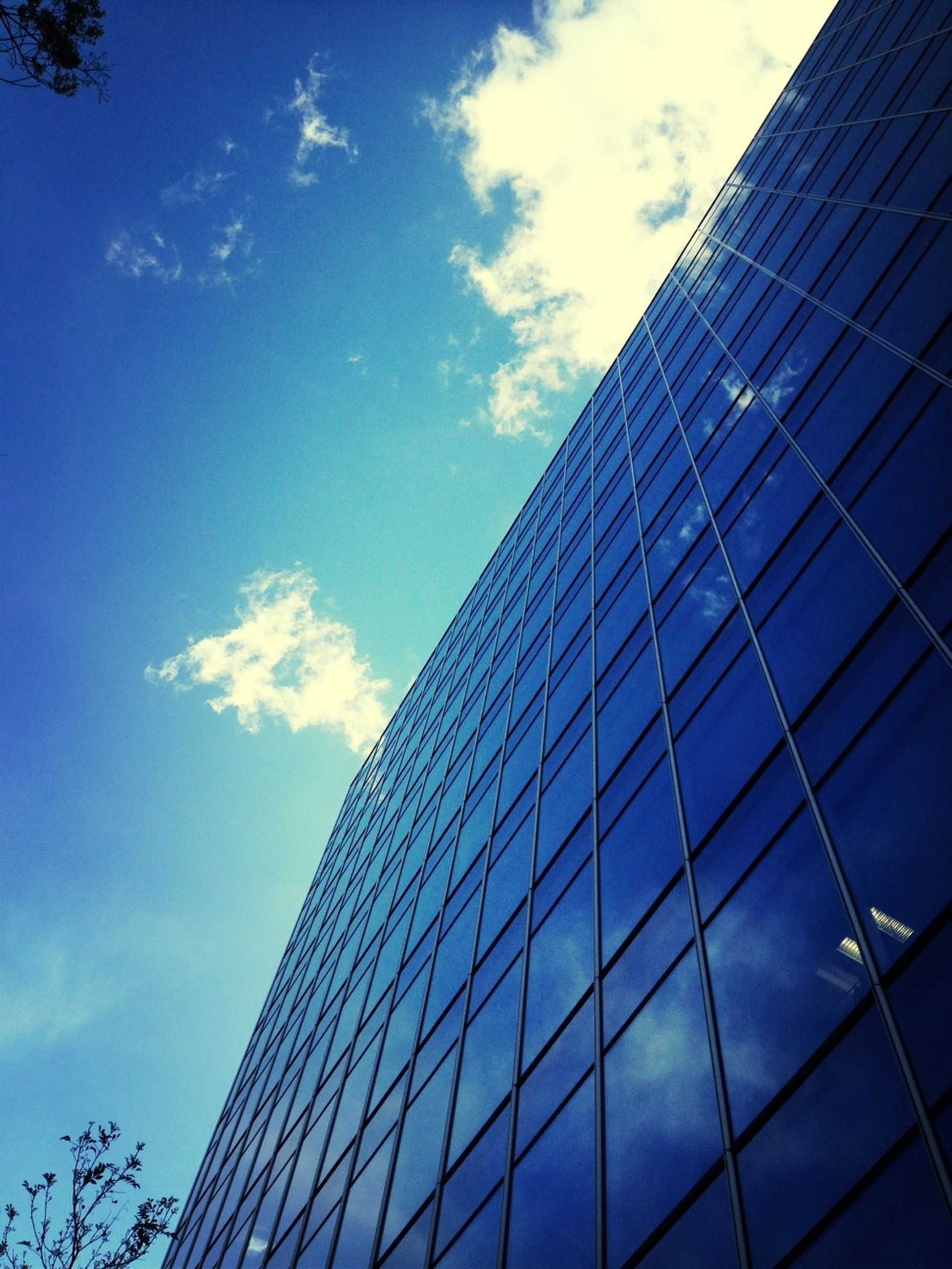 architecture, building exterior, built structure, low angle view, modern, office building, reflection, sky, skyscraper, glass - material, city, tall - high, blue, tower, building, cloud - sky, cloud, day, glass, window