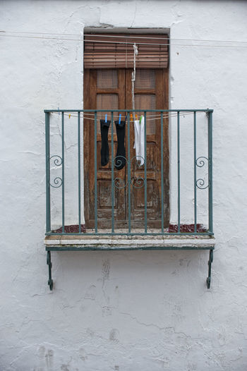 Old Balcony Doors Old Window Spanish Scenery Architecture Building Exterior Built Structure Day Decaying Building Hanging Clothes Hanging Socks No People Old Balconery Old Balcony Old Buildings Outdoors Solitude Spanish Arquitecture Window