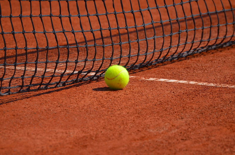 At the tennis court. Tennis Ball Absence Activity At The Edge Of Ball Close-up Competition Court Day Leisure Activity Middle Line Net No People Outdoors Recreational Pursuit Selective Focus Single Object Sport Sports Equipment Tennis Tennis Ball Tennis Court Tennis Net