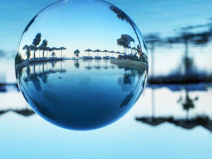 Close-up of glass against blue sky