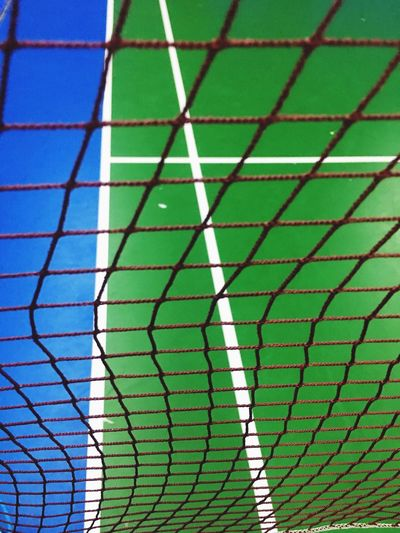 Singles or doubles? No People Day Built Structure Architecture Pattern Green Color Full Frame Outdoors Low Angle View Backgrounds Close-up Badminton