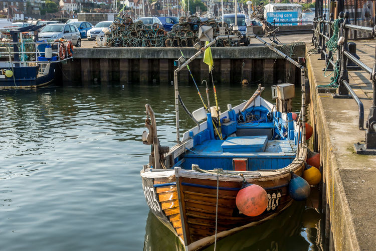 Whitby Whitby Harbour Whitby View Whitby North Yorkshire North Yorkshire Yorkshire Tourist Destination Sunny Day Blue Sky Seaside Seaside Town Fishing Boat Fishing Industry Crab Pots Lobster Pots Nautical Vessel Waterfront Harbor Rowboat No People Reflection Moored Day Water Transportation