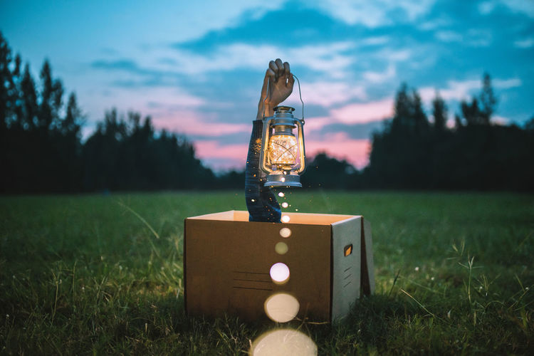"""Light up the night."" The magic box with the lantern. 🔮 Celebration Christmas Halloween Lantern Light Lighting Equipment Lights Nightphotography Art And Craft Cloud - Sky Grass Hand Land Landscape Light And Shadow Magic Male Likeness Nature Night Plant Representation Sky Sunset Toy Tree"