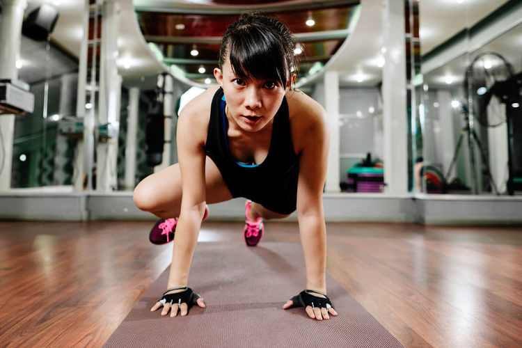 asian fitness model stretching in gym for HIIT training. Hiit workout indoors. One Person Sport Exercising Young Adult Indoors  Lifestyles Healthy Lifestyle Gym Sports Clothing Strength Effort Asian  Stretching Yoga Plank Body & Fitness Pump Fitness Fitness Training Model Woman Sexygirl Brunette EyeEm Best Shots