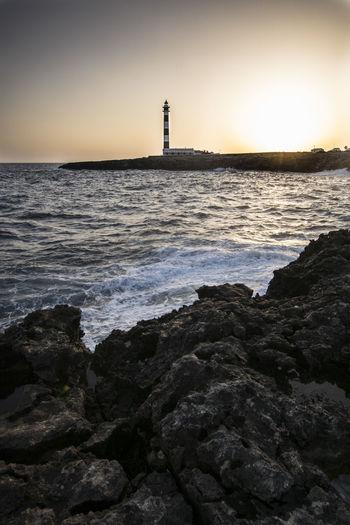 Faro d'artrutx Menorca Faro Sea Whater Light Dark Lights Nature Landscape Sea Lighthouse Beach Sunset Silhouette Water's Edge Sky Horizon Over Water Building Exterior