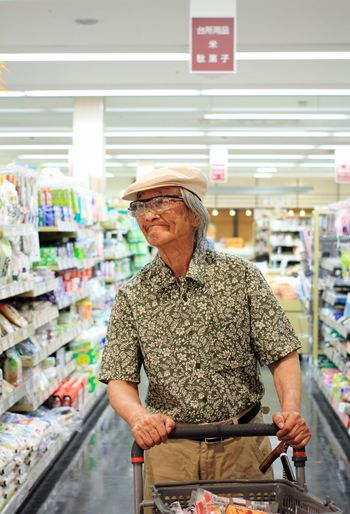 Senior man shopping at supermarket