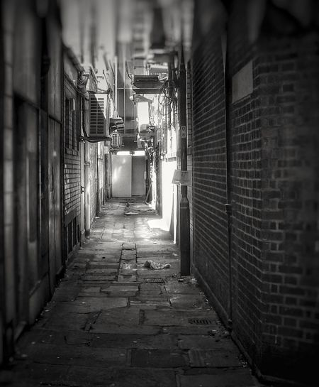 One of the back streets of Manchester Brick Wall Built Structure Architecture Streets Of Manchester Malephotographerofthemonth Creative Light And Shadow The World Through My Eyes Fujifilm Manchester UK Street Photography Streetphoto_bw Streetphotography Black And White Photography Masterclass Bnw_captures Monochrome Photography
