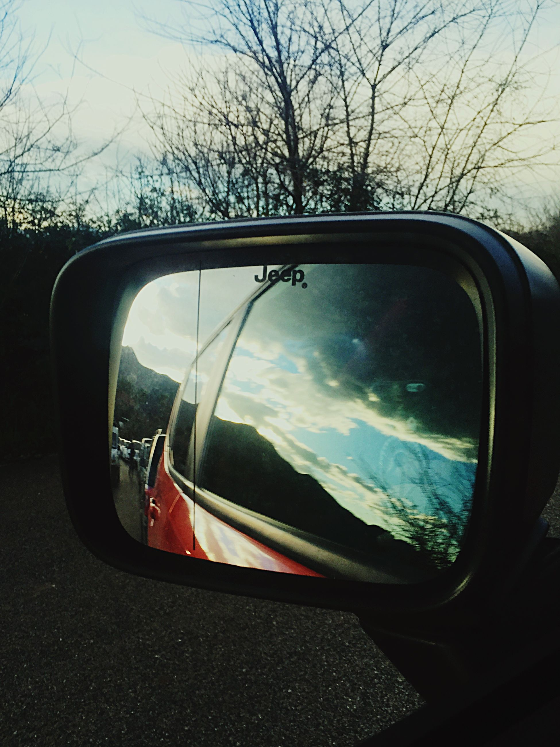 transportation, mode of transport, car, land vehicle, side-view mirror, vehicle interior, reflection, car interior, glass - material, travel, transparent, part of, windshield, tree, sky, road, cropped, window, bare tree, on the move