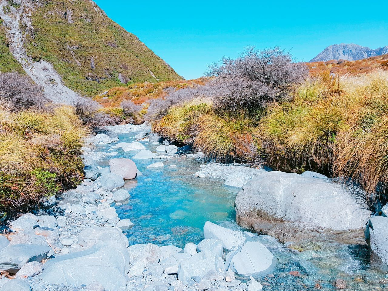 nature, beauty in nature, tranquil scene, scenics, water, outdoors, tranquility, day, river, non-urban scene, landscape, no people, tree, mountain, hot spring, clear sky, sky