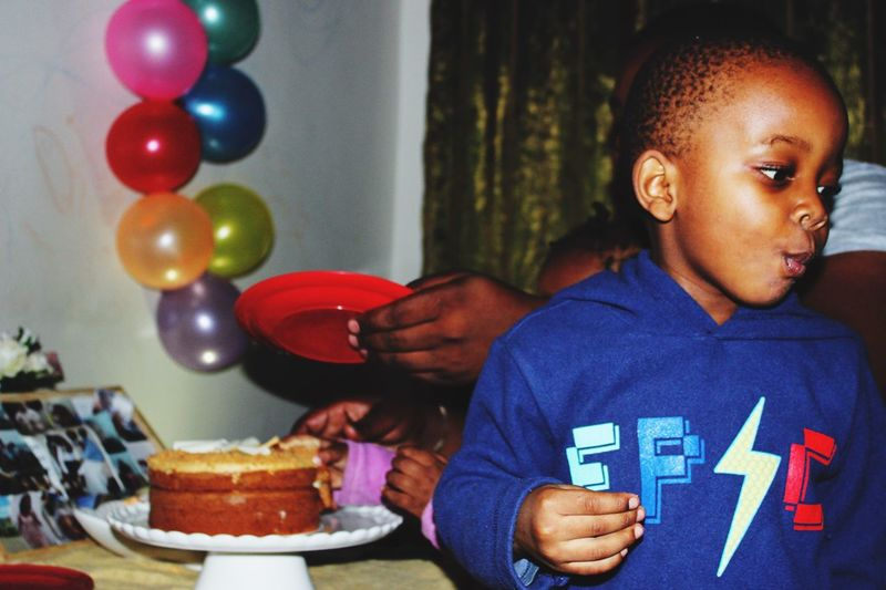 Boy Looking Away During Birthday Celebration At Home