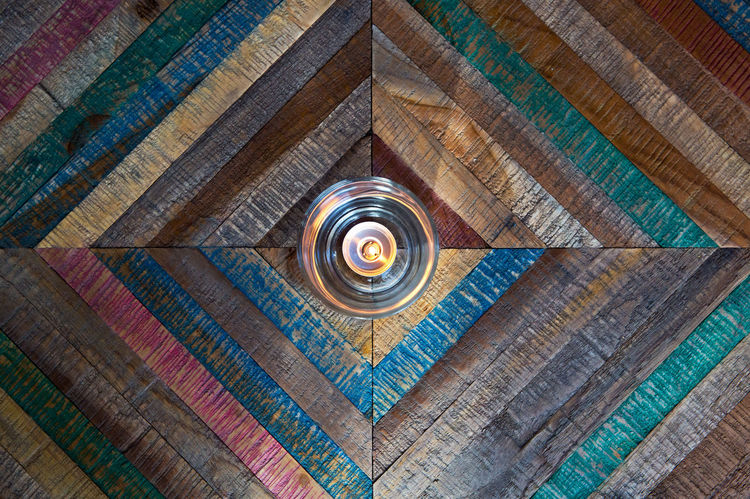Wood - Material Pattern Indoors  No People Built Structure Shape Geometric Shape Design Ceiling Circle Backgrounds Full Frame Day Directly Below Lighting Equipment Multi Colored Religion Brown Candlelight Candle Decoration Multicolored Colored Wood Symmetry