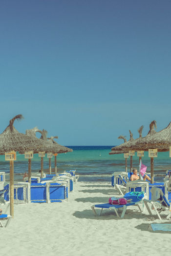 Sky Sea Water Beach Land Horizon Over Water Clear Sky Sand Nature Outdoors Parasols Beach Photography Vacations Holiday Copy Space Sunny Travel Destinations Copy Space Scenics - Nature Tranquility Portrait