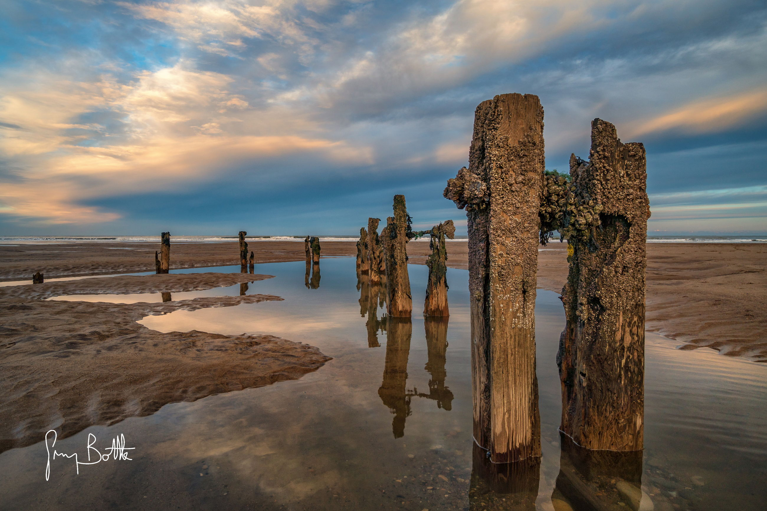 sky, cloud - sky, beach, tranquility, outdoors, nature, water, sea, no people, tranquil scene, day, scenics, sand, horizon over water, wooden post, beauty in nature