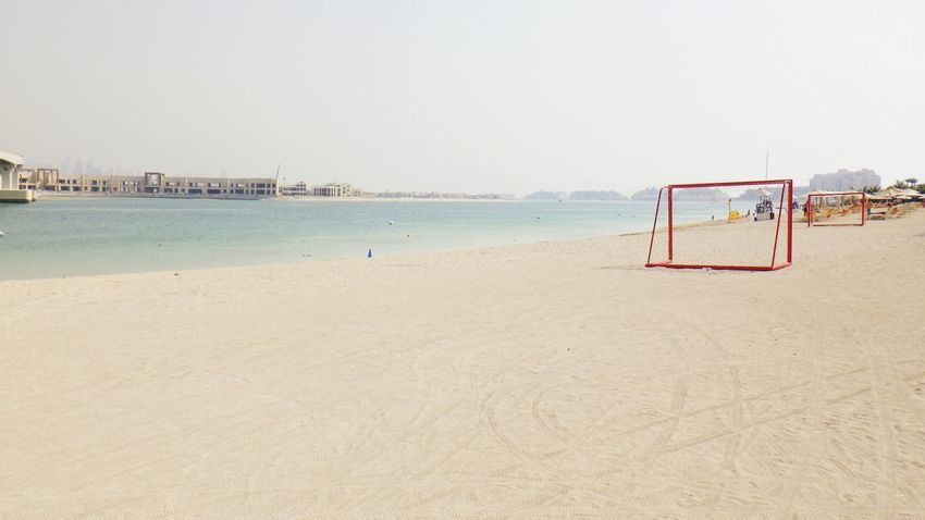 EyeEm Selects Beach Sand Sea Copy Space Water Shore Nature Day Outdoors Clear Sky Tranquility Scenics Beauty In Nature Horizon Over Water No People Beach Volleyball Sky Football Dubai Atlantis The Palm