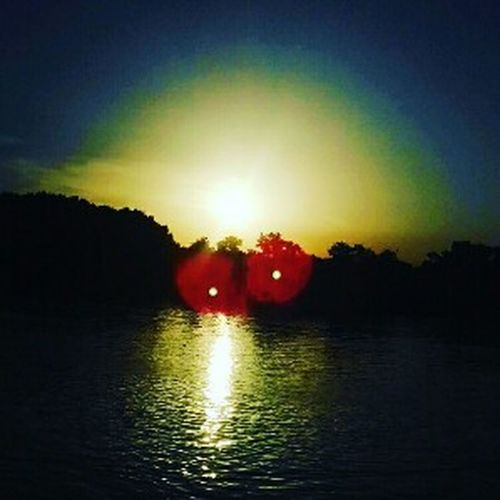 Paint The Town Yellow Beauty In Nature Illuminated Lake Nature Night No People Outdoors Reflection Scenics Silhouette Sky Sunset Tranquil Scene Tranquility Tree Water