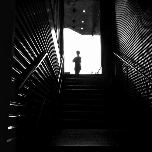 Low angle view of man on stairs
