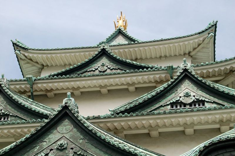 Low angle view of temple roof against sky
