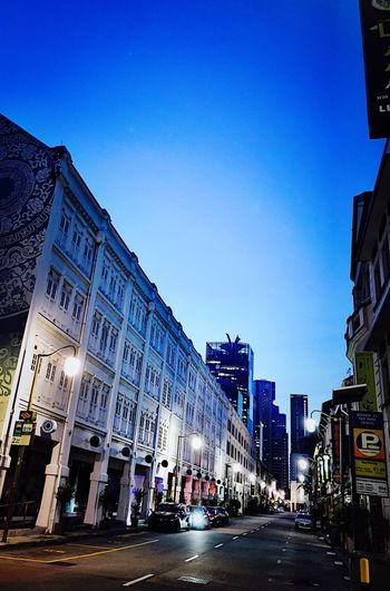 Singapore Building Exterior City Architecture Sky Street Built Structure Clear Sky Transportation Nature Building Motor Vehicle Mode Of Transportation Car City Street Land Vehicle Road Blue Incidental People City Life Illuminated