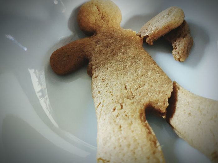 High angle view of broken gingerbread man in plate