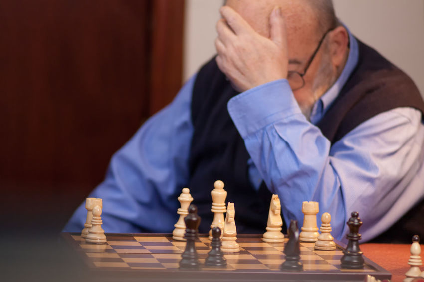old man losing chess match Losing Man Thinking Challenge Checkmate Chess Chess Board Chess Piece Close-up Competition Competitive Detail Figures Human Hand Indoors  Intelligence Leisure Activity Leisure Games Move Old Play Player Playing Senior Adult Strategy