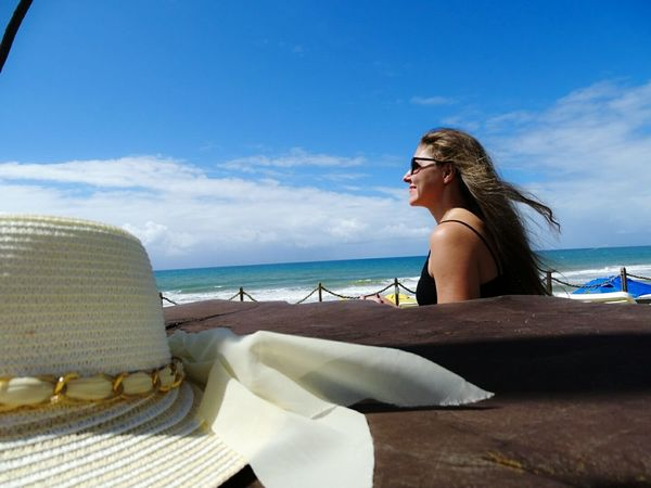 Young Adult Sea Beach Horizon Over Water Tranquil Scene Side View Tranquility Getting Away From It All Sitting Sky Beauty Outdoors Clear Sky Feeling Happy Tropical Climate Brazil Peacefulness Salvador Brazilian Woman Bahia Hat Relaxation Long Hair Young Women Vacation Time