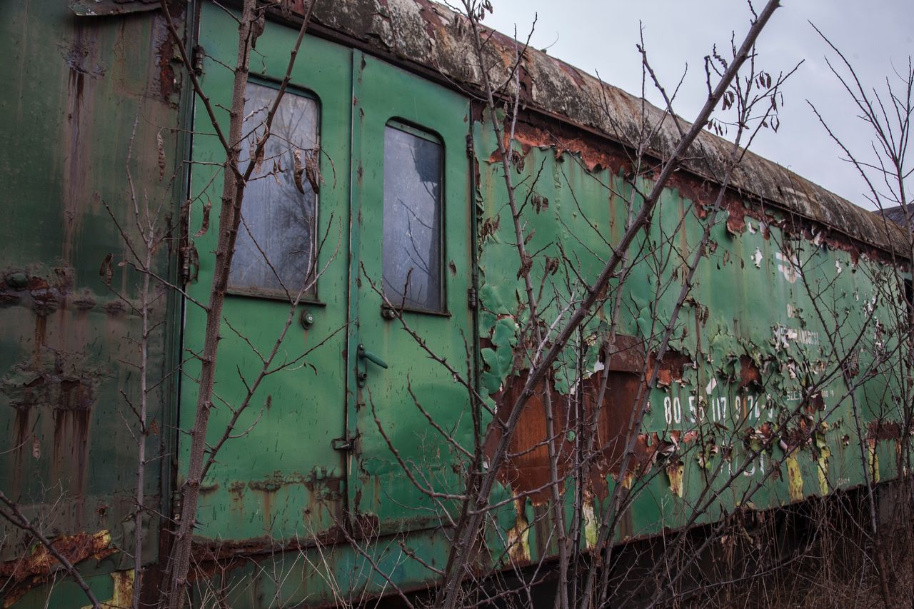 architecture, abandoned, built structure, building exterior, run-down, damaged, old, weathered, decline, no people, deterioration, building, bad condition, day, plant, obsolete, broken, nature, house, destruction, outdoors, ruined