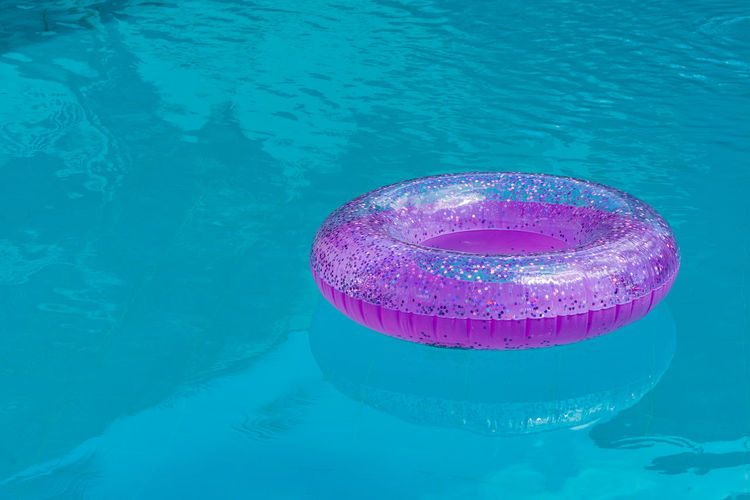 Pink donut floating in a pool Background Beauty Blue Calm Caribbean Colors Concept Cuba Cyan Day Donut Floating Fun Game Havana Holiday Holidays Hotel Hotel Pool Industry Inflatable Donut Multicolor Multicolored No People Outdoor Pink Pink Color Places Pool Relax Relaxation Safety Scene Sequins Spangle Sport Spring Summer Tourism Tourists Travel Travel Destination Urban Vacations Water Waves Swimming Pool Waterfront Nature Floating On Water High Angle View Purple Outdoors Transparent Reflection Inflatable  Swimming Tubing Turquoise Colored Purity